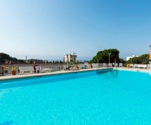 Apartamento   Lloret del Mar para 4 personas con piscina comunitaria y cerca del mar p0