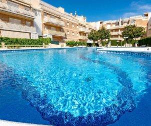 Apartamento   Cunit para 5 personas con piscina comunitaria p0