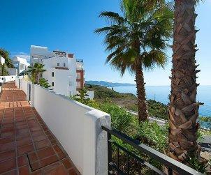 Apartamento   Torrox Costa para 2 personas con piscina comunitaria p0