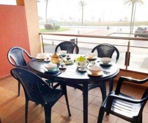 Apartamento   Empuriabrava para 7 personas con piscina comunitaria, vista mar y aere acondicionado p0