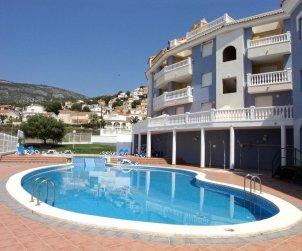 Apartamento   Alcocéber - Alcossebre para 8 personas con piscina comunitaria y aere acondicionado p0